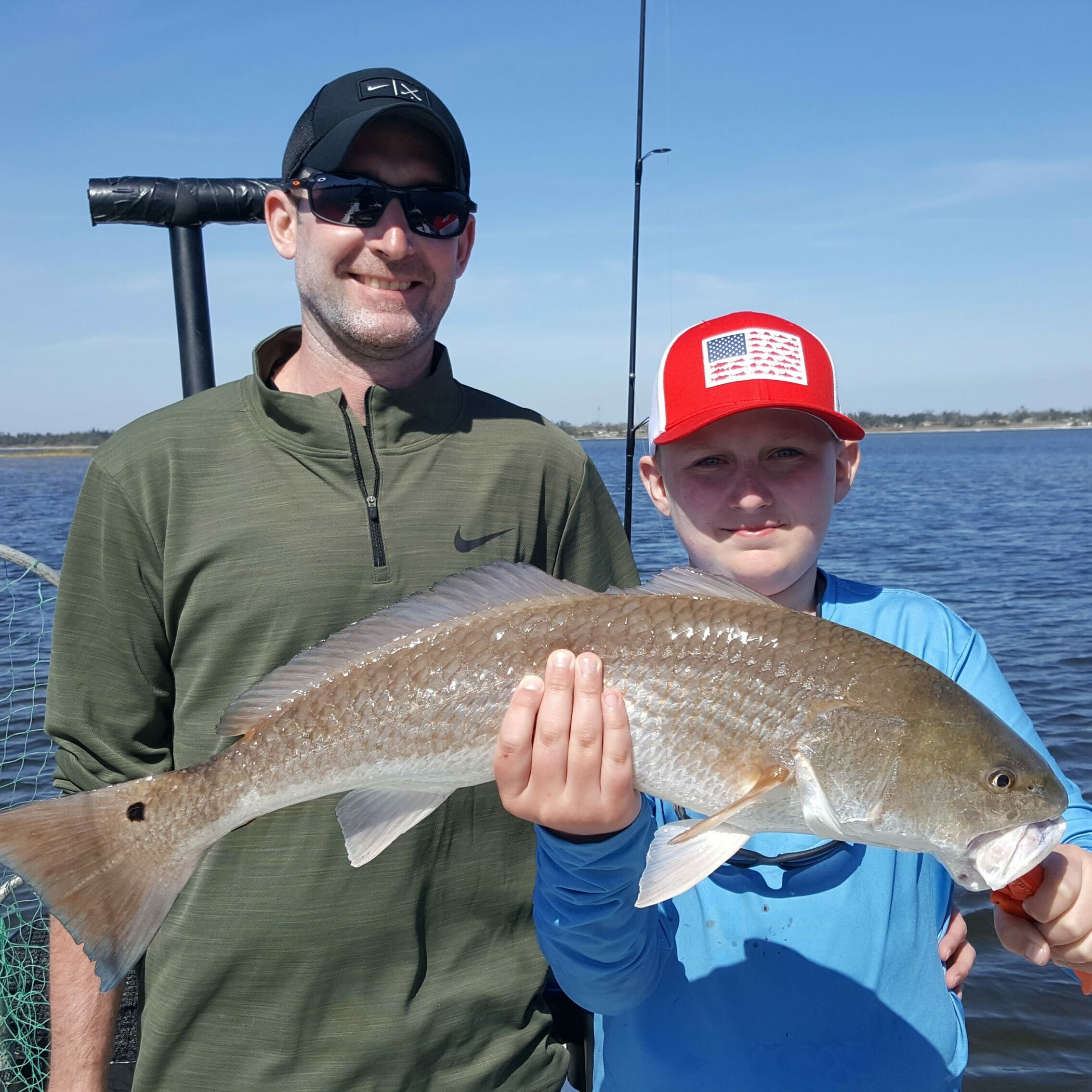 03 14 21 Andy and Aiden Slot Redfish